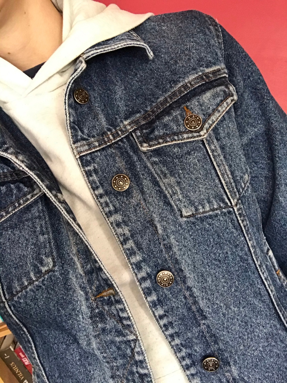 Girl wearing white shirt under a jean jacket from thrift store